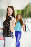 Pretty lady showing credit card in the mall Royalty Free Stock Photography
