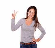 Pretty lady showing victory sign with her fingers Stock Image