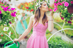 Pretty lady smelling the flowers Royalty Free Stock Images
