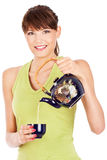Pretty lady smile and pouring tea from teapot Royalty Free Stock Photo