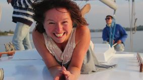 Pretty lady smiling at camera, enjoying rest on sailing yacht. Stock footage stock footage