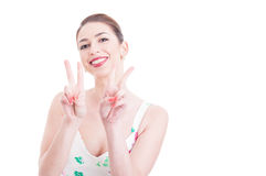 Pretty lady smiling and showing victory sign with both hands. Pretty lady smiling and being happy showing victory sign with both hands isolated on white Royalty Free Stock Photography