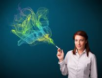 Pretty lady smoking cigarette with colorful smoke Royalty Free Stock Images