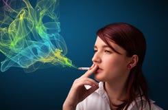 Pretty lady smoking cigarette with colorful smoke Stock Photos