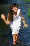 Pretty lady splashing in the stream Stock Image