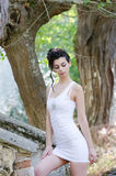Pretty lady standing front old house wearing a tight short white dress Royalty Free Stock Photos