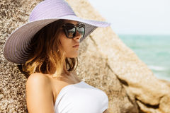 Pretty lady in summer outfit on the beach. stock image