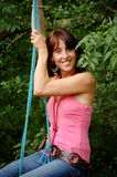 Pretty lady on a swing!. A pretty lady enjoying herself on a swing stock images