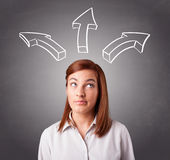 Pretty lady thinking with arrows overhead Stock Images