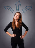Pretty lady thinking with arrows overhead Stock Image