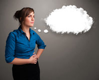 Pretty lady thinking about cloud speech or thought bubble with c Stock Photo