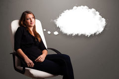 Pretty lady thinking about cloud speech or thought bubble with c Stock Photography