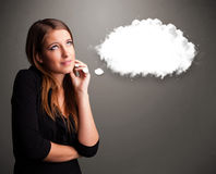 Pretty lady thinking about cloud speech or thought bubble with c Stock Image