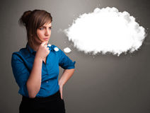 Pretty lady thinking about cloud speech or thought bubble with c Stock Images