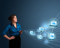 Pretty lady typing on smartphone with cloud computing Stock Images