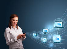 Pretty lady typing on smartphone with cloud computing Stock Image
