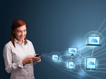 Pretty lady typing on smartphone with cloud computing Stock Photo