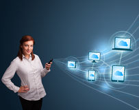 Pretty lady typing on smartphone with cloud computing Royalty Free Stock Photo