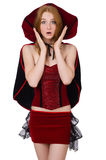 Pretty lady in velvet bordo dress with cap Royalty Free Stock Images