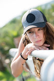 Pretty lady wear hat and leaning on a iron rail Stock Photography