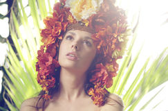 Pretty lady wearing hat made of flowers Stock Images