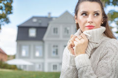 Pretty lady wearing thick sweater Royalty Free Stock Photos