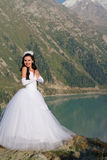 Pretty lady in a wedding dress in mountain Royalty Free Stock Images