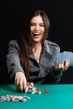 Pretty lady wiining blackjack game at casino. Beautiful lady wiining blackjack game at casino royalty free stock image