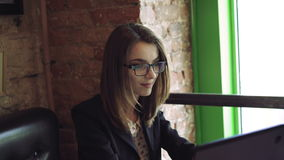 Pretty lady working with a laptop in comfortable cafe 4k stock video footage