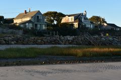 Pretty landscape of pretty cape houses looking out to the atlant. Beautiful landscape on the coast of cape cod Stock Images