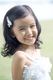 Pretty lass in flower girl attire Royalty Free Stock Photos