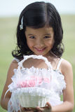 Pretty lass in flower girl attire Stock Images