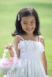Pretty lass in flower girl attire Royalty Free Stock Images