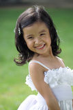 Pretty lass in flower girl attire Stock Photos