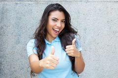 Pretty latin american woman with long hair showing both thumbs u Royalty Free Stock Photography