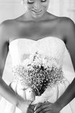 Pretty latin bride holding flower bouquet Stock Photography