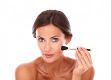 Pretty latin female applying facial care product Stock Photography