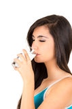 Pretty latin girl drinking water from a glass Stock Photos