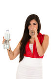 Pretty latin girl drinking water from a glass Stock Images