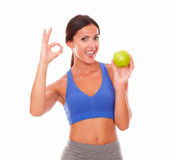 Pretty latin lady on diet holding fruit Stock Photography