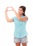 Pretty latin lady looking at a love sign stock images