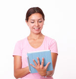 Pretty latin lady working with her tablet pc Stock Photography