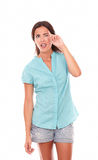 Pretty latin woman in blue blouse pointing up Stock Images