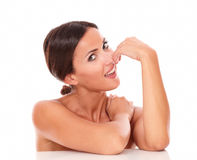 Pretty latin woman showing her femininity. Head and shoulders portrait of pretty latin woman showing her femininity with nude shoulders while smiling at camera Stock Image