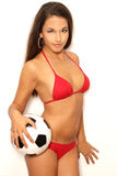 Pretty latina with ball in studio stock photography