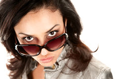 Pretty Latina Woman Looking Over Her Glasses Stock Photography