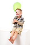 Pretty laughing boy with balloon Royalty Free Stock Images
