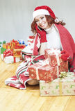 Pretty and Laughing Red-Haired Cucasian Santa Girl With a Bunch Royalty Free Stock Image