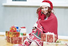 Pretty and Laughing Red-Haired Cucasian Santa Girl With a Bunch Stock Image