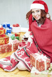 Pretty and Laughing Red-Haired Cucasian Santa Girl With a Bunch Stock Images